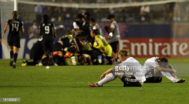 Dzsenifer Marozsan and Carolin Simon of Germany look dejected after the FIFA U20 Women's World Cup Japan 2012 Final match between USA and Germany at...