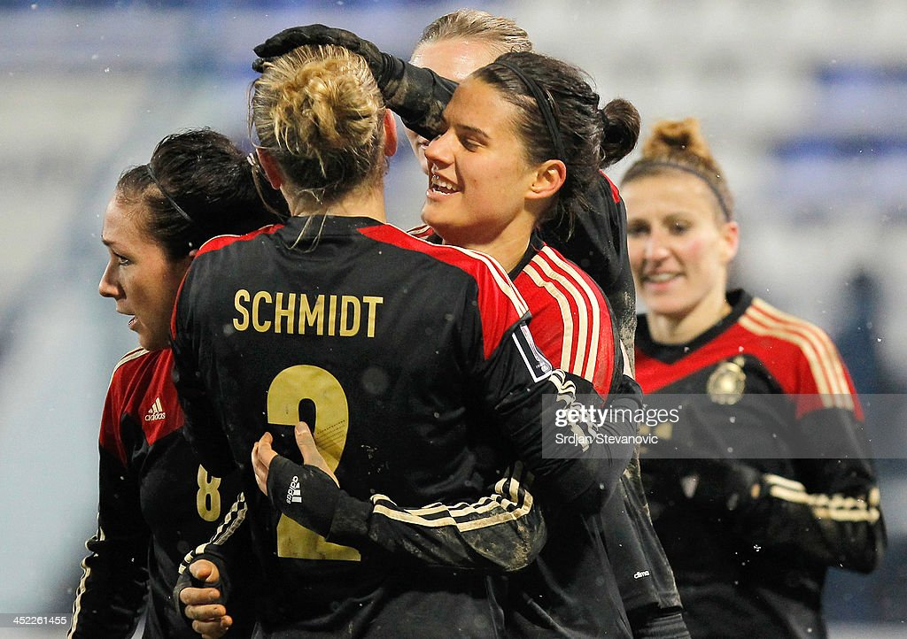 Dzsenifer Marozsan (R) celebrate the goal with Bianca Ursula Schmidt (L) of Germany during the FIFA Women's World Cup 2015 Qualifier between Croatia and Germany at Stadion Gradski Vrt on November 27, 2013 in Osijek, Croatia.