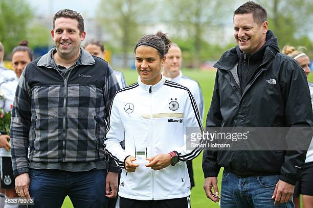 Dzsenifer Marozsan is presented with the 'Player of Algarve Cup' award during a Germany Women's Training Session at SC Kaefertal Training Ground on...