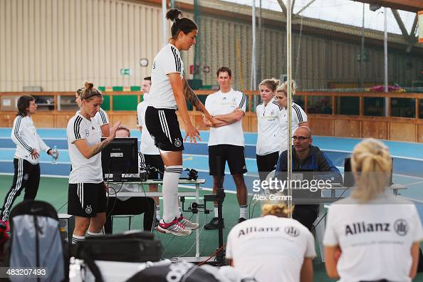 Dzsenifer Marozsan jumps during a Germany women's national team performance test on April 7 2014 in Mannheim Germany
