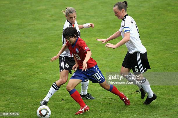 Dzsenifer Marozsan Marina Hegering of Germany and Ji So Yun of South Korea battle for the ball during the FIFA U20 Women's World Cup Semi Final match...