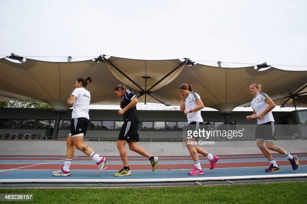 Dzsenifer Marozsan Nadine Angerer Annike Krahn and Bianca Schmidt run during a Germany women's national team performance test on April 7 2014 in...