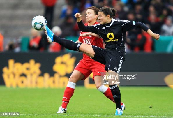 Dzsenifer Marozsan of Frankfurt and Joseph Henning of Potsdam battle for the ball during the DFB Women's Cup final match between 1 FFC Frankfurt and...