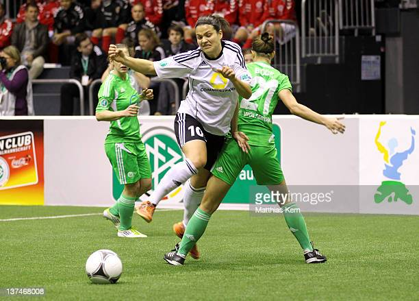 Dzsenifer Marozsan of Frankfurt is challenged by Stephanie Bunte of Wolfsburg during the DFB Women's Indoor Cup at GETECArena on January 21 2012 in...