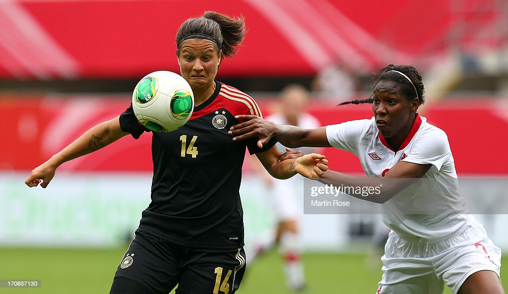 Dzsenifer Marozsan (L) of Germany and Kadeisha Buchanan of Canada battle for the ball during the Women's International Friendly match between Germany and Canada at Benteler Arena on June 19, 2013 in Paderborn, Germany.