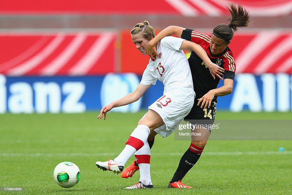 Dzsenifer Marozsan (R) of Germany and Sophie Schmidt of Canada battle for the ball during the Women's International Friendly match between Germany and Canada at Benteler Arena on June 19, 2013 in Paderborn, Germany.