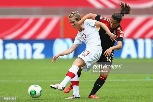 Dzsenifer Marozsan of Germany and Sophie Schmidt of Canada battle for the ball during the Women's International Friendly match between Germany and...