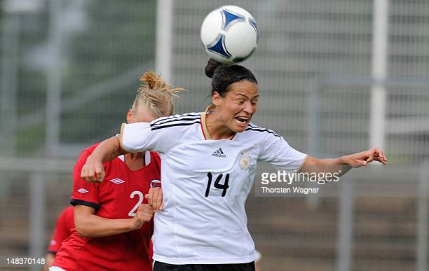 Dzsenifer Marozsan of Germany battles for the ball with Anja Soenstevold of Norway during the women's U20 international friendly match between...