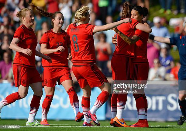Dzsenifer Marozsan of Germany celebrates her team's second goal with team mates during the women's international friendly match between Switzerland...