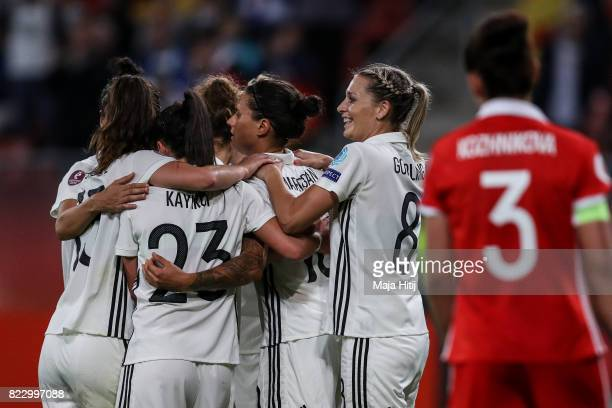 Dzsenifer Marozsan of Germany celebrates scoring her sides second goal with her German team mates during the Group B match between Russia and Germany...