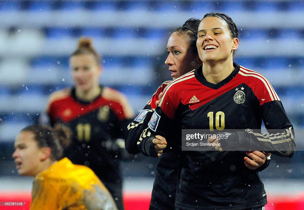 Dzsenifer Marozsan (R) of Germany celebrates the goal during the FIFA Women's World Cup 2015 Qualifier between Croatia and Germany at Stadion Gradski Vrt on November 27, 2013 in Osijek, Croatia.