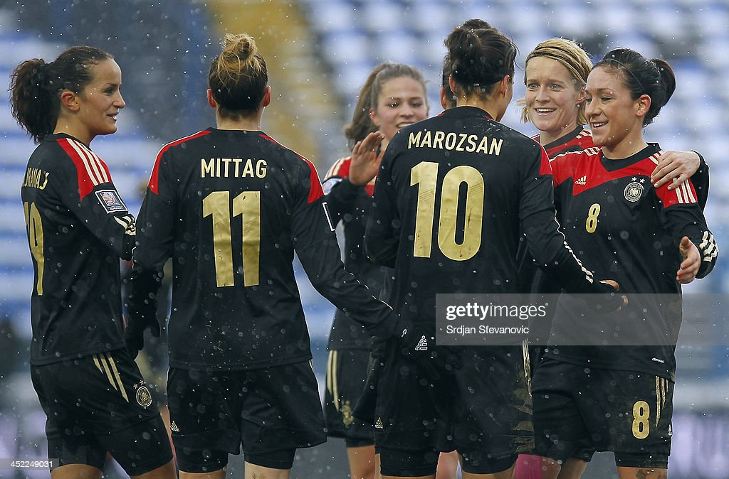 Dzsenifer Marozsan (C) of Germany celebrates the goal with Nadine Kessler (R) and Anja Mittag (L) of Germany during the FIFA Women's World Cup 2015 Qualifier between Croatia and Germany at Stadion Gradski Vrt on November 27, 2013 in Osijek, Croatia.