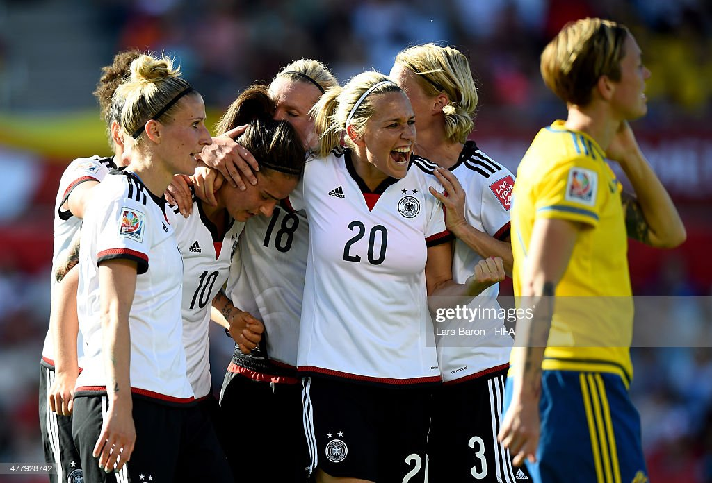 Dzsenifer Marozsan of Germany celebrates with Lena Goessling of Germany and other team mates after scoring her teams fourth goal during the FIFA Women's World Cup 2015 Round of 16 match between Germany and Sweden at Lansdowne Stadium on June 20, 2015 in Ottawa, Canada.