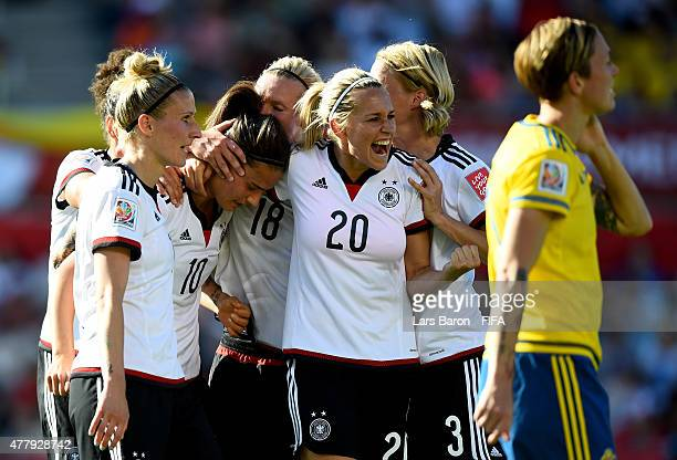 Dzsenifer Marozsan of Germany celebrates with Lena Goessling of Germany and other team mates after scoring her teams fourth goal during the FIFA...