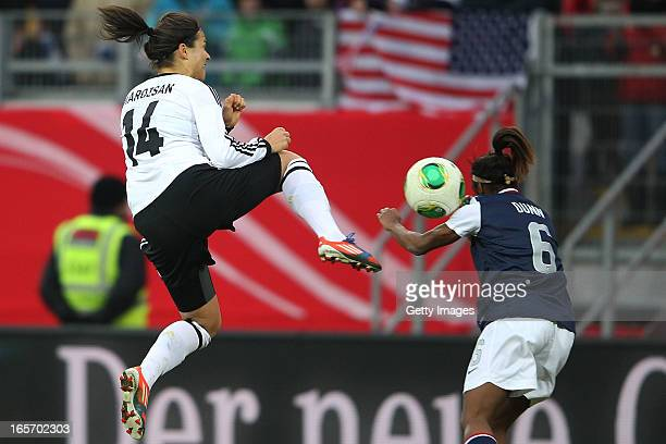Dzsenifer Marozsan of Germany is challenged by Chrystal Dunn of the United States during the Women's International Friendly match between Germany and...