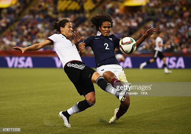 Dzsenifer Marozsan of Germany is challenged by Wendie Renard of France during the quarter final match of the FIFA Women's World Cup between Germany...