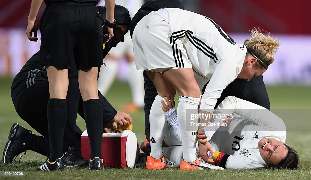 Dzsenifer Marozsan of Germany is lying on the field injured during the women's international friendly match between Germany and Norway at community4you ARENA on November 29, 2016 in Chemnitz, Germany.