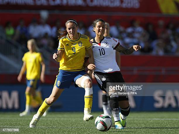 Dzsenifer Marozsan of Germany is tackled by Kosovare Asllani of Sweden during the FIFA Women's World Cup 2015 round of 16 match between Germany and...