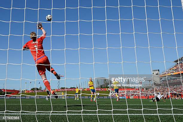 Dzsenifer Marozsan of Germany scores the fourth goal past Hedvig Lindahl of Sweden during the FIFA Women's World Cup Canada 2015 Round of 16 match...