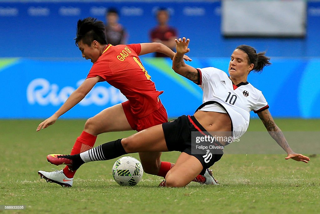 Dzsenifer Marozsan of Germany tackles Chen Gao of China during the Women's Football Quarterfinal match between China and Germany on Day 7 of the Rio 2016 Olympic Games at Arena Fonte Nova on August 12, 2016 in Salvador, Brazil.
