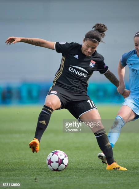 Dzsenifer Marozsan of Olympique Lyonnais and Kosovare Asllani of Manchester City in action during the UEFA Women's Champions League semi final first...