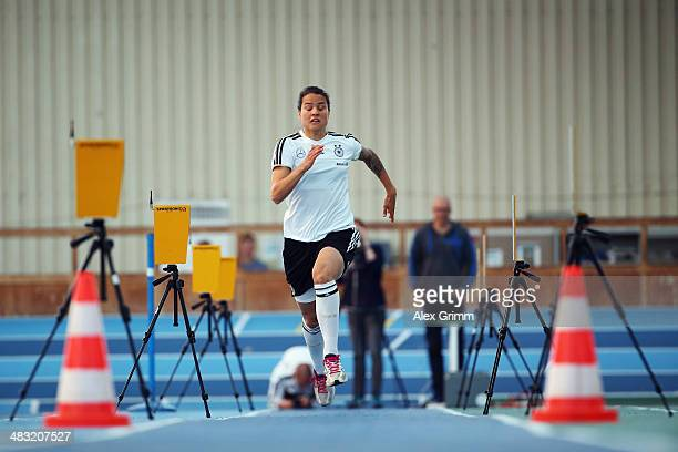 Dzsenifer Marozsan runs during a Germany women's national team performance test on April 7 2014 in Mannheim Germany