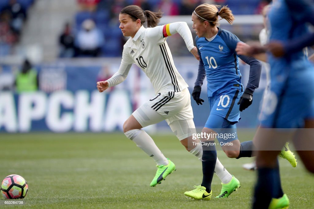 Dzsenifer Marozsán #10 of Germany is challenged by Camille Abily #10 of France during the France Vs Germany SheBelieves Cup International match at Red Bull Arena on March 4, 2017 in Harrison, New Jersey.