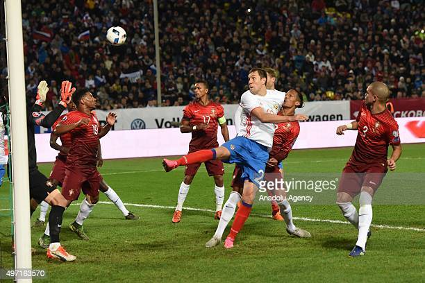 Dzyuba of Russia and his opponent contest the ball during the friendly match between Russia and Portugal at Kuban Stadium in Krasnodar Russia on...