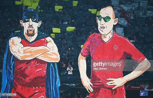 e fans of Bayern Muenchen make character figures of Franck Ribery and Arjen Robben as batman and robin prior to the start of the DFB Cup semi final...