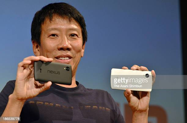 eAccess President Eric Gan introduce LG's Nexus 5 smartphones during a press conference on November 1 2013 in Tokyo Japan The company becomes the...
