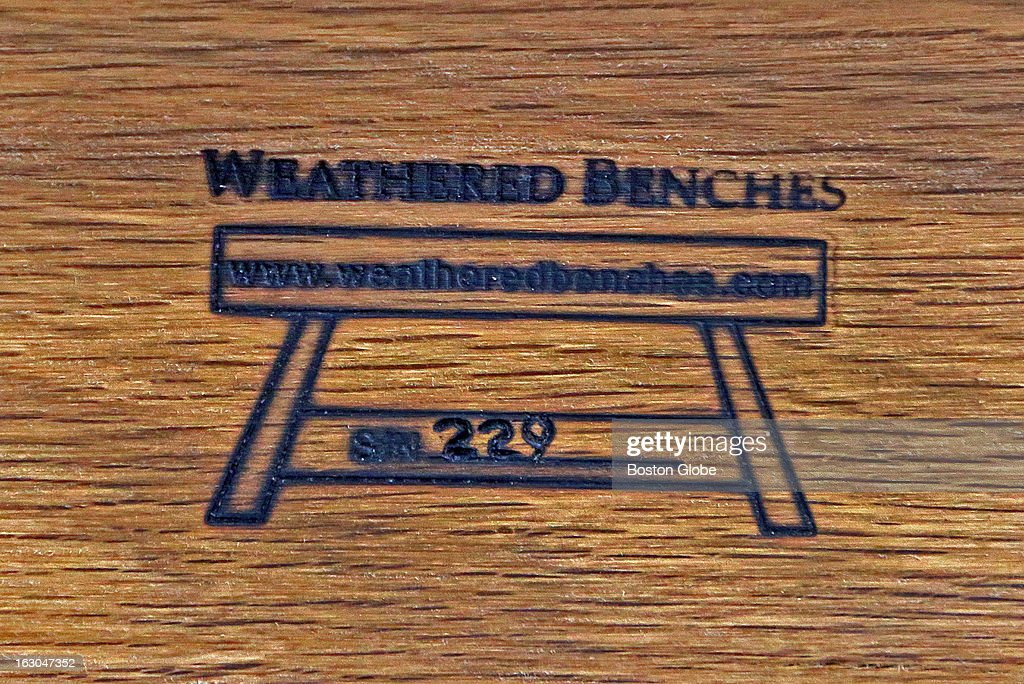Each bench made of wood from reclaimed USS Constitution timbers dug up from the Charlestown Naval Yard is branded and numbered on the bottom. This is Weathered Benches number 229.