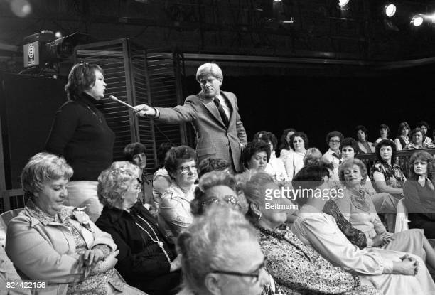 Each day some 200 women are seated on metal chairs in the Donahue studio to see and participate in the show There is a live telephone on the set and...