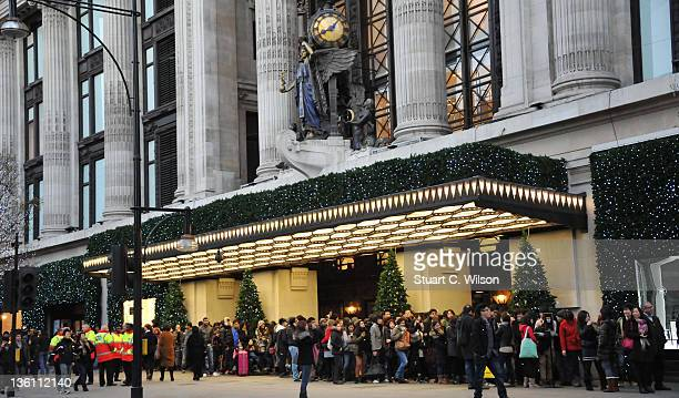 Eager shoppers queue outside Selfridges department store on Oxford Street for the Boxing Day sales on December 26 2011 in London England Dubbed 'Mega...