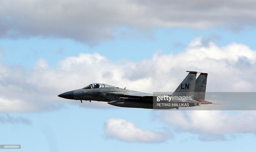 Eagle jet fighter flies over air force base during the US Senators visit to the US Air Force currently deployed on NATOs Baltic Air Policing mission...