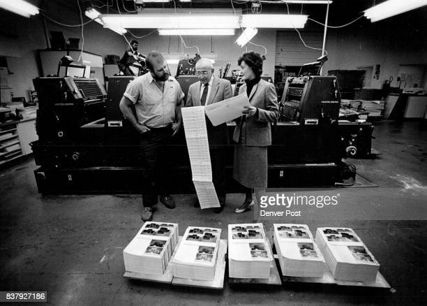 Eagle Lithographics in the pressroom looking at the computer copy of the budget Left to right Mike Mason Asst Pressroom Supervisor Gerald Harris...