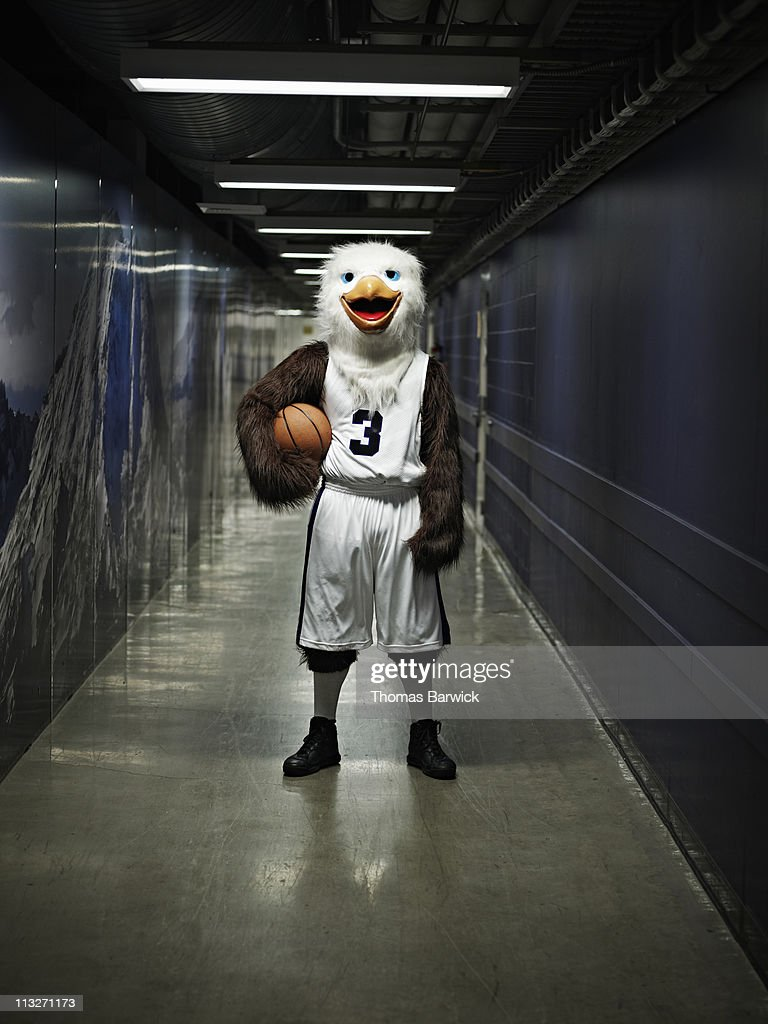 Eagle mascot standing in hallway of arena : Photo