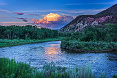 Eagle River Summer View - Scenic landscape with mountains, river and sunset reflections.  Colorado, USA.