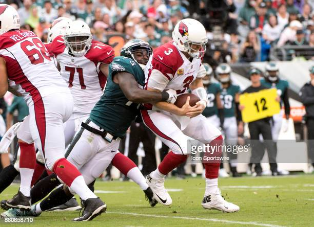 Eagles DE Vinny Curry brings down Cardinals QB Carson Palmer in the first half during the game between the Arizona Cardinals and Philadelphia Eagles...