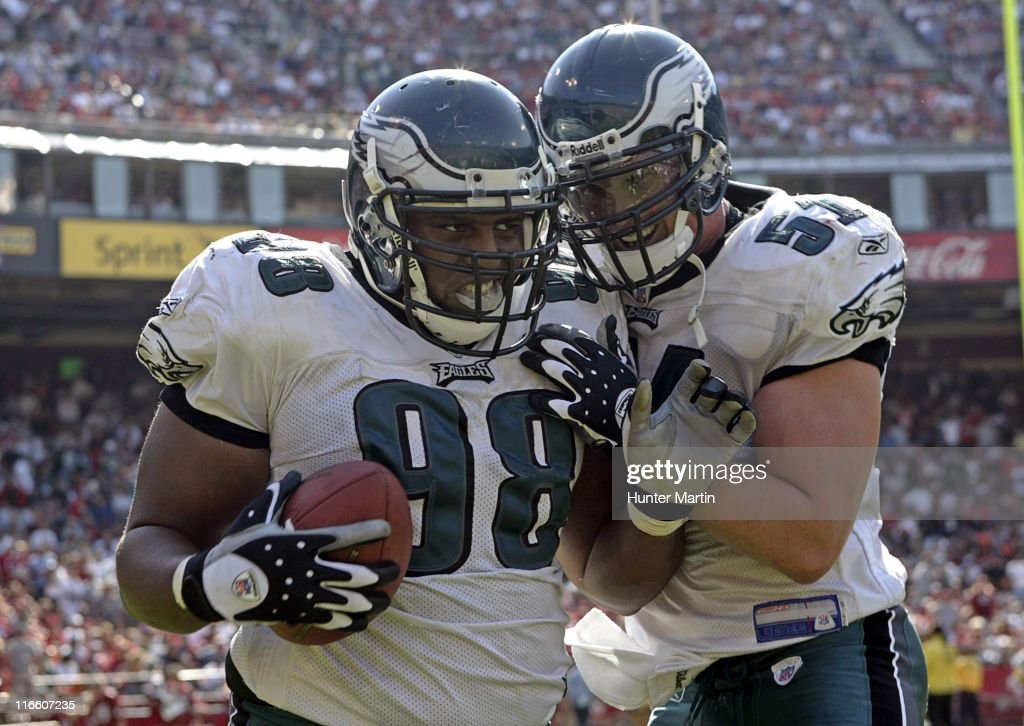 Eagles defensive tackle Mike Patterson celebrates after returning a fumble recovery for a touchdown versus the San Francisco 49ers at Monster Park in...