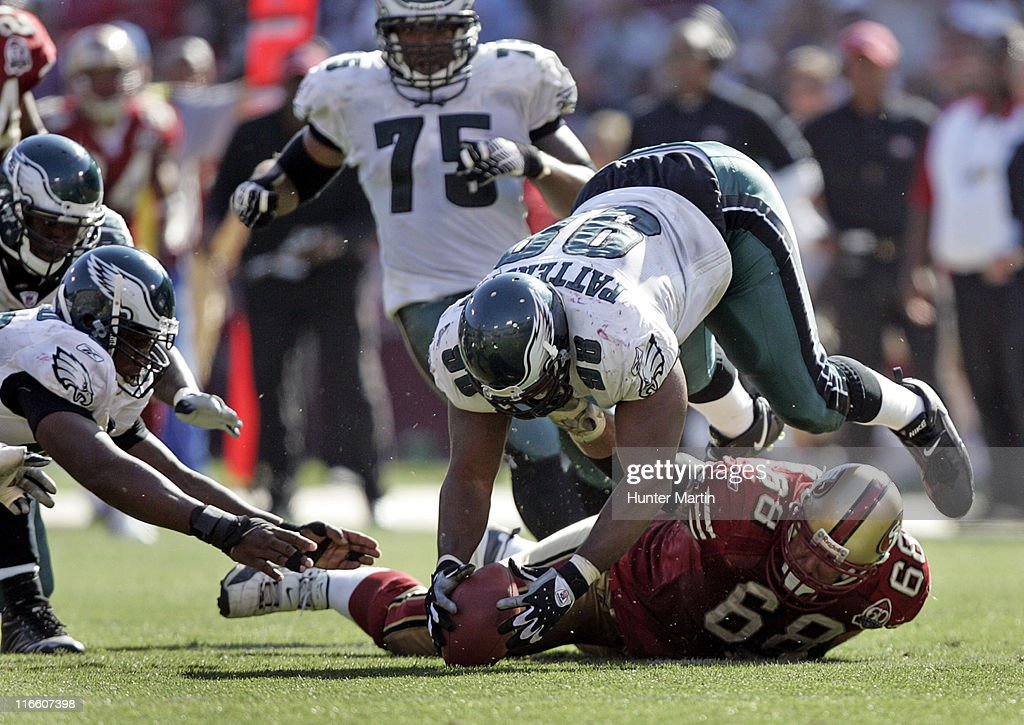 Eagles defensive tackle Mike Patterson jumps on a loose ball during the fourth quarter versus the San Francisco 49ers at Monster Park in San...