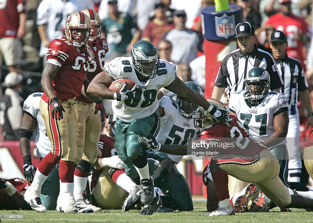 Eagles defensive tackle Mike Patterson returns a fumble recovery for a touchdown versus the San Francisco 49ers at Monster Park in San Francisco...