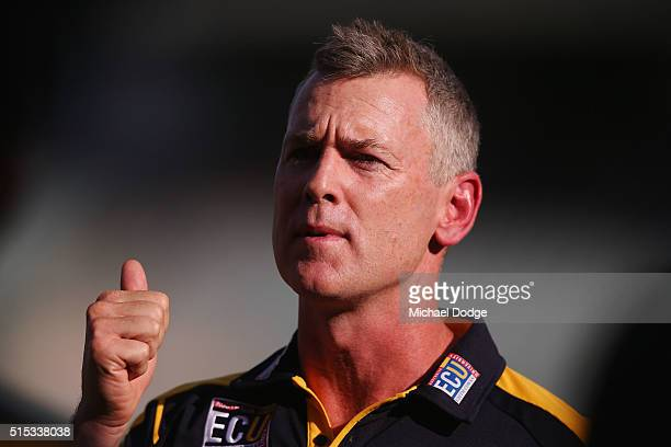 Eagles head coach Adam Simpson speaks to his players during the NAB Challenge AFL match between the West Coast Eagles and the Essendon Bombers at...