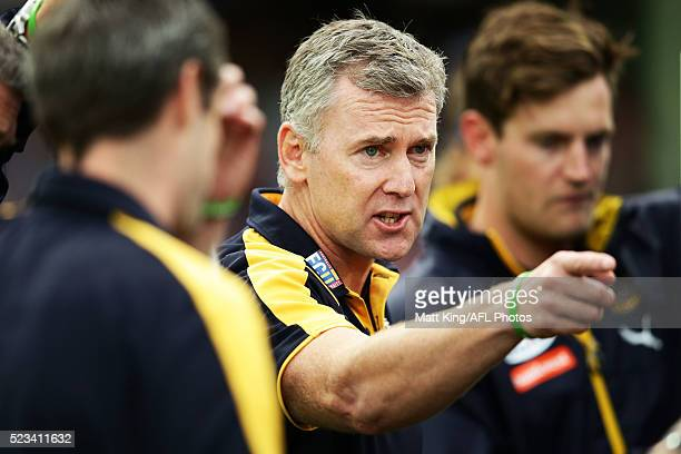 Eagles head coach Adam Simpson speaks to players at three quarter time during the round five AFL match between the Sydney Swans and the West Coast...