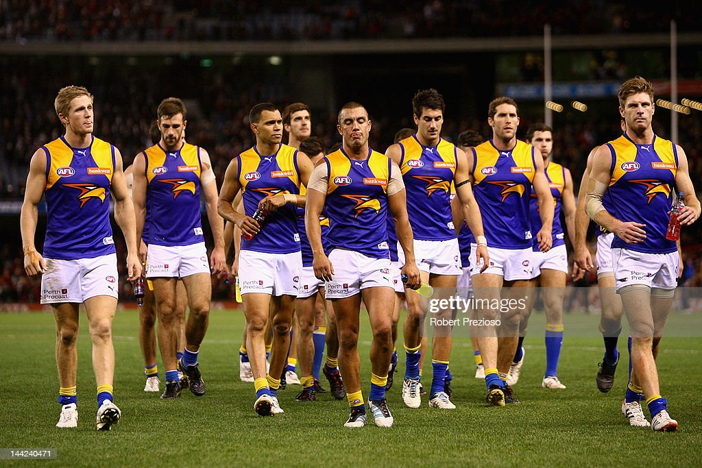 Eagles players walk off the field after the round seven AFL match between the Essendon Bombers and the West Coast Eagles at Etihad Stadium on May 12, 2012 in Melbourne, Australia.
