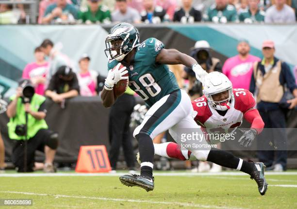 Eagles RB Kenjon Barner flies past a diving Cardinals S Budda Baker in the first half during the game between the Arizona Cardinals and Philadelphia...