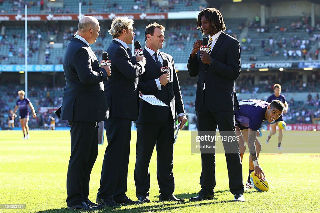 Eagles ruckman Nic Naitanui (R) talks for Fox Sports during the round one AFL match between the Fremantle Dockers and the West Coast Eagles at Patersons Stadium on March 23, 2013 in Perth, Australia.