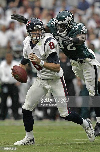 Eagles safety Michael Lewis pressures Texans quarterback David Carr during the second quarter at Reliant Stadium Houston Texas September 10 2006
