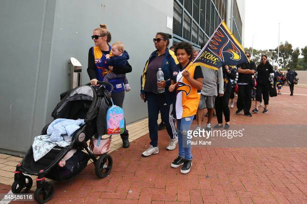 Eagles supporters queue to enter the ground during a West Coast Eagles AFL training session at Domain Stadium on September 11 2017 in Perth Australia