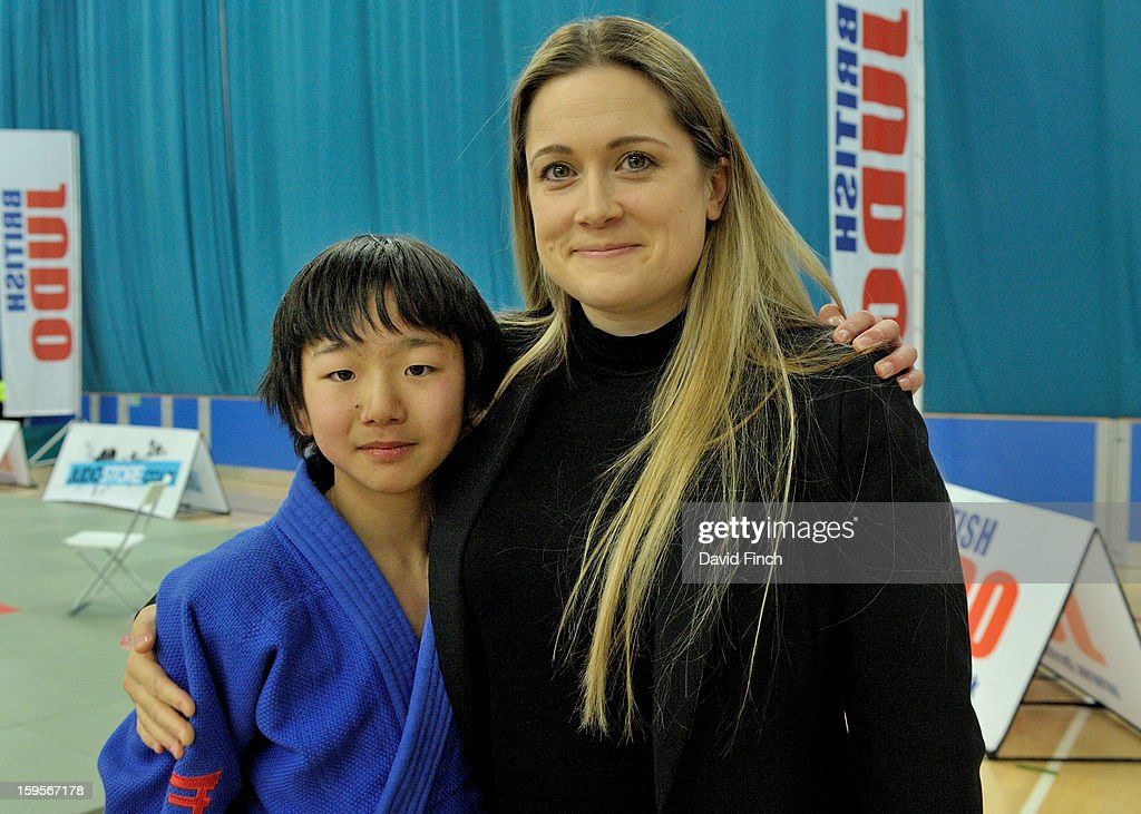 Ealing Judo Club's coach, Jo Crowley, proudly hugs Showgo Kimura who won the Pre Cadet Boy's under 46kgs gold medal during the British Cadet and Pre-Cadet Judo Championships on day 1, Sunday, January 13, 2013 at the English Institute of Sport, Sheffield, England, UK.