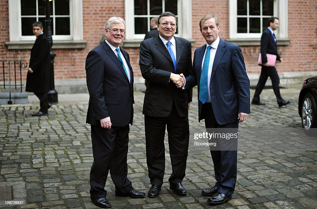 <a gi-track='captionPersonalityLinkClicked' href=/galleries/search?phrase=Eamon+Gilmore&family=editorial&specificpeople=7484923 ng-click='$event.stopPropagation()'>Eamon Gilmore</a>, Ireland's deputy prime minister, left, and <a gi-track='captionPersonalityLinkClicked' href=/galleries/search?phrase=Enda+Kenny&family=editorial&specificpeople=5129605 ng-click='$event.stopPropagation()'>Enda Kenny</a>, Ireland's prime minister, right, greet <a gi-track='captionPersonalityLinkClicked' href=/galleries/search?phrase=Jose+Manuel+Barroso&family=editorial&specificpeople=551196 ng-click='$event.stopPropagation()'>Jose Manuel Barroso</a>, president of the European Commission, as he arrives for their meeting at Dublin Castle in Dublin, Ireland, on Thursday, Jan. 10, 2013. Ireland's government said it sold its entire 1 billion euros ($1.3 billion) of so-called contingent convertible capital notes in Bank of Ireland Plc as investors bid for almost five times the amount on offer. Photographer: Aidan Crawley/Bloomberg via Getty Images
